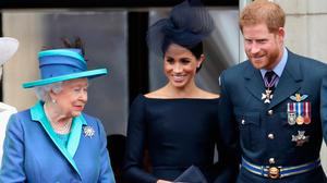 Queen Elizabeth II, Meghan, Duchess of Sussex, Prince Harry, Duke of Sussex watch the RAF flypast on the balcony of Buckingham Palace, as members of the Royal Family attend events to mark the centenary of the RAF on July 10, 2018 in London, England. (Photo by Chris Jackson/Getty Images)