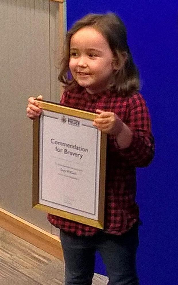 Four-year-old Suzie McCash with her Commendation for Bravery Photo: Northumbria Police
