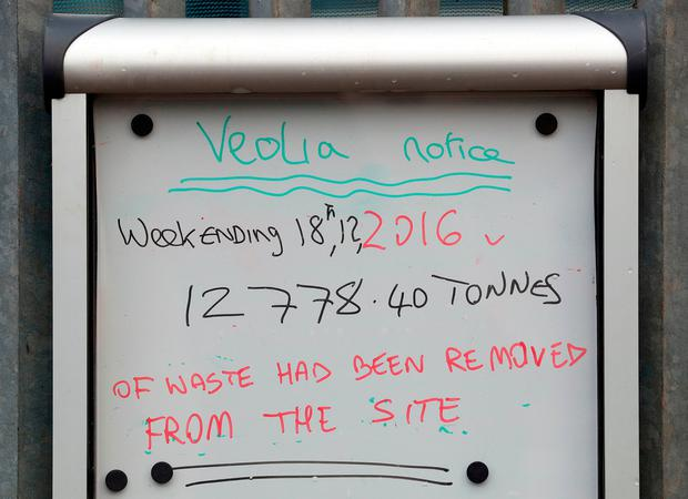 A sign by the decreasing mountain of rubbish which has been at the bottom of residential cul-de-sac, Cornwall Drive in St Paul's Cray, Orpington, Kent, as work continues to remove the waste from the area. Photo: Gareth Fuller/PA Wire