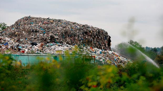 The mountain of rubbish at the bottom of a residential cul-de-sac, Cornwall Drive in St Paul's Cray, Orpington, Kent. The site is continuing to be cleared with over 12,000 tonnes removed so far. Photo: Gareth Fuller/PA Wire