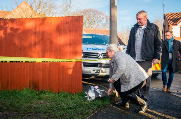 The grandparents of the victim leave a floral tribute near Alness Drive in the Woodthorpe area of York, where a teenager was arrested Monday after the death of a seven-year-old girl. Photo: Danny Lawson/PA Wire