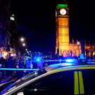 Police in Parliament Square, London, as a suspected unexploded Second World War bomb has been found in the River Thames, forcing the closure of Waterloo and Westminster bridges in London. Photo: Stefan Rousseau/PA Wire