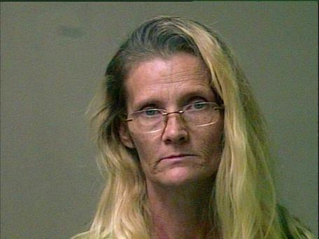 Robinson painted her hands green, wore a wig and a mask to evoke her alter-ego 'Nelda' Photo: Oklahoma City Police