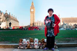 Claire Throssell, whose children were killed by her abusive ex-husband in 2014, lays 20 teddy bears in Westminster symbolising the children who have died as a result of unsafe child contact with a parent who is a perpetrator of domestic abuse, after she delivered a petition to Downing Street. Photo: Stefan Rousseau/PA Wire