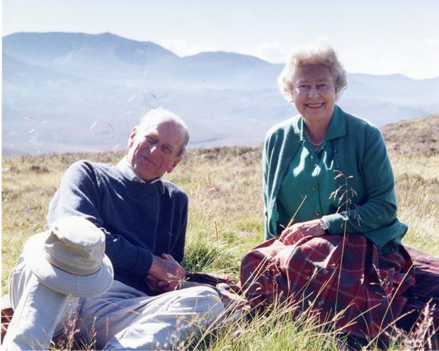 The picture released by Buckingham Palace of a personal photograph of the Britain's Queen Elizabeth II and Prince Philip, the Duke of Edinburgh at the top of the Coyles of Muick, taken by The Countess of Wessex in 2003. Picture: Reuters
