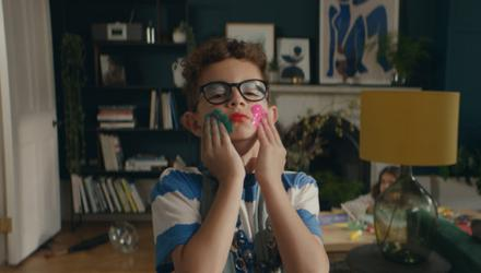 The advert featured a young boy dressed up in his mother's clothes causing damage to his home.