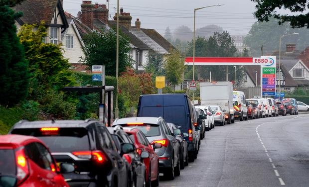 Motorists queue for fuel at an ESSO petrol station in Ashford, Kent. Photo: Gareth Fuller/PA Wire