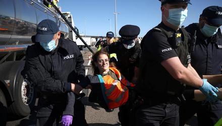 Police officers arrest a protestor from the group Insulate Britain at the entrance to the of Port of Dover. Photo: Reuters/ Henry Nicholls