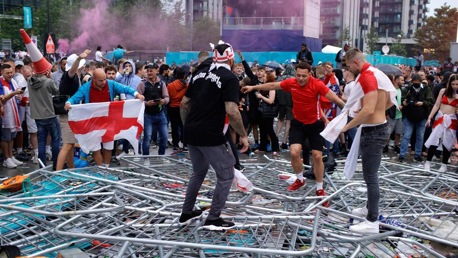Supporters trample on barricades outside Wembley Stadium. Photo: David Cliff/AP