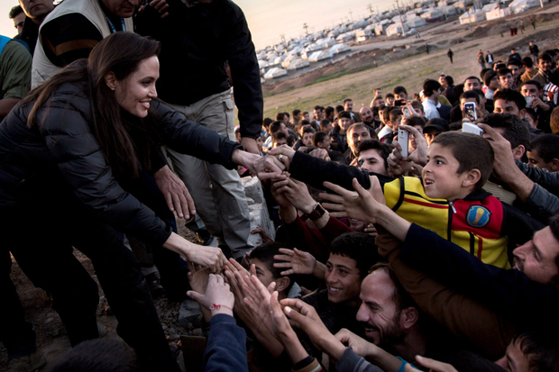 United Nations Special Envoy Angelina Jolie meets Syrian refugees and displaced Iraqi citizens in Iraq earlier this year. The UN has just marked its 70th anniversary in trying to save 'succeeding generations from scourge of war'