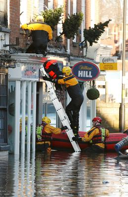 Rescuers help with the evacuation on a flooded street in Tadcaster, northern England Photo: Reuters