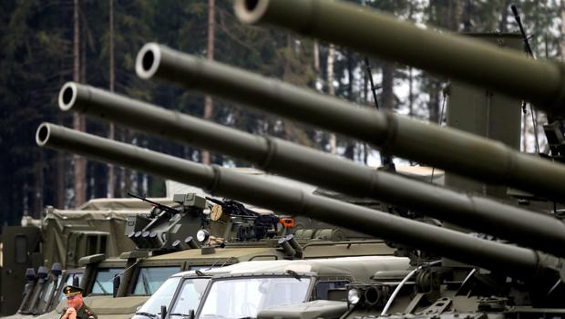 A Russian serviceman stands next to tanks and armoured vehicles at the Army-2015 international military forum in Kubinka, outside Moscow, Russia.
