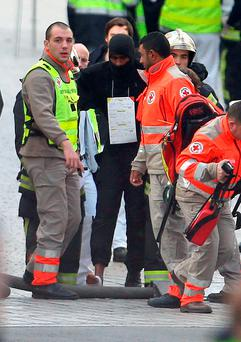 A wounded police officer during a raid on an apartment in the Saint-Denis suburb of Paris