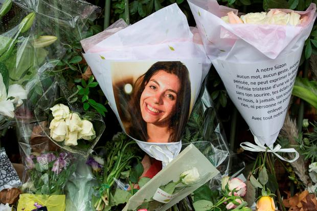 A photograph of one of the victims of the Bataclan attack in Paris places across the road from the theatre