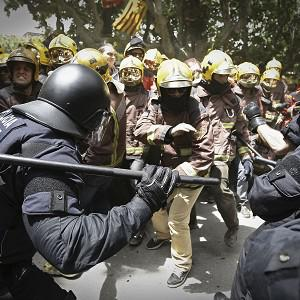 Police charge at firefighters during a protest against austerity measures in Spain (AP)