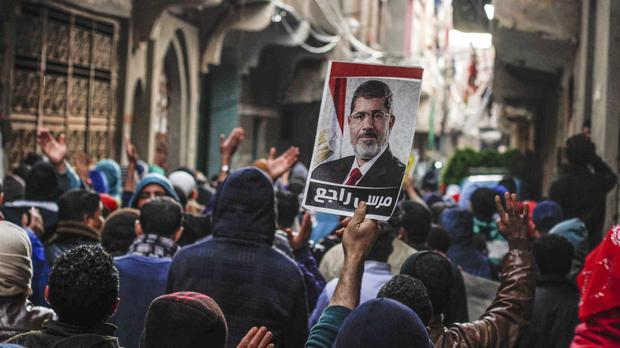 Supporters of ousted Islamist president Mohamed Morsi take to the streets as security forces kill a senior Muslim Brotherhood leader (AP)