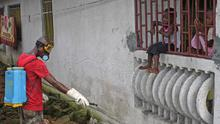 A man sprays chemicals to try and prevent the spread of the Ebola virus in Monrovia, Liberia (AP)