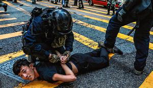 Tensions high: Police detain a demonstrator during a protest in the Central district of Hong Kong. Photo: AFP via Getty Images