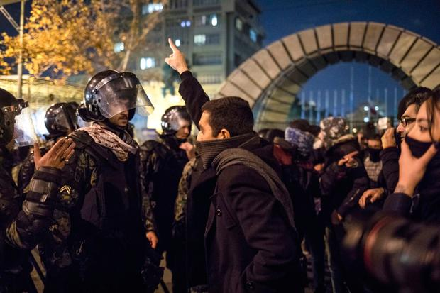 Rising tension: An Iranian man confronts riot police during a protest outside Tehran's Amir Kabir University. Photo: AFP