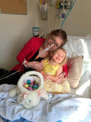 Melissa Benoit with her daughter Olivia prior to a lung transplant. Doctors in Canada saved her life by removing her lungs for six days while she waited for the transplant