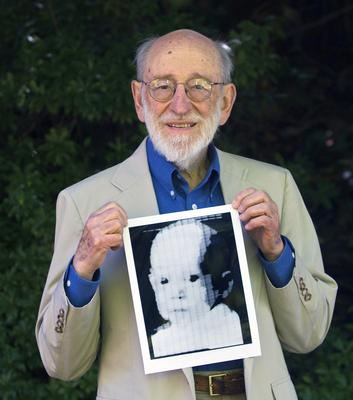 Russell Kirsch holding the image of his son, Walden, that was scanned into the world's first digital scanner in 1957 (Jamie Francis/The Oregonian via AP, File)