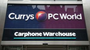 Dixons Carphone has seen shares surge ahead after revealing booming online trading (PA)