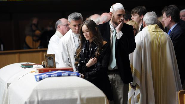Amanda Donohoe looks at her sister's casket during a service for Olivia Burke and Ashley Donohoe at St Joseph Catholic Church in California (AP)