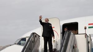 Narendra Modi boards his plane at Kabul International Airport in Afghanistan. (AP)