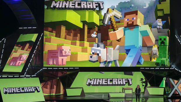 Lydia Winters shows off Microsoft's Minecraft built specifically for HoloLens during a live demo at the Xbox E3 2015 briefing (AP)