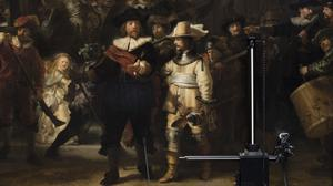 Equipement for analysing the painting's condition is seen next to Rembrandt's Night Watch (Peter Dejong/AP)