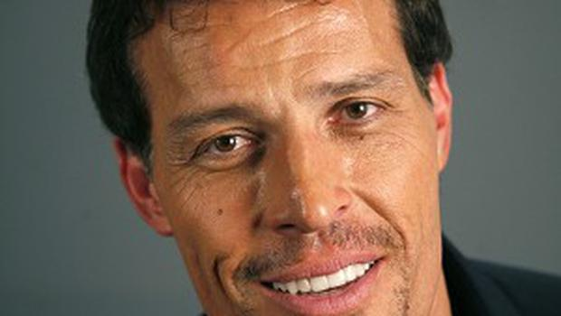 At least 21 people were treated for burns after attendees of an event for motivational speaker Tony Robbins tried to walk on hot coals (AP)