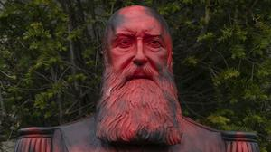 A bust of Belgium's King Leopold II is smeared with red paint and graffiti in Tervuren, Belgium (Virginia Mayo/AP)