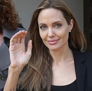 Angelina Jolie waves as she leaves the government palace in Beirut, Lebanon (AP)