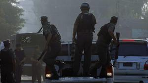 Pakistani commandos arrive at an air force base in Peshawar after it was attacked by militants (AP)