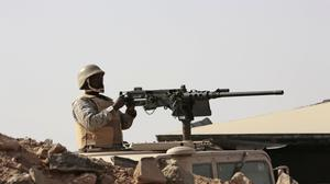 A Saudi soldier aims his weapon at a military point in Najran, Saudi Arabia. (AP)