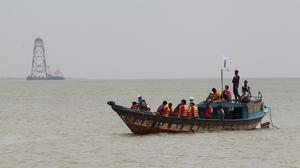 Bangladeshi rescuers search the River Padma after a ferry capsized (AP)