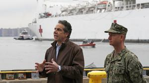 New York Governor Andrew Cuomo, left, speaks as he stands beside Rear Adm. John B. Mustin after the arrival of the USNS Comfort (Kathy Willens/AP)
