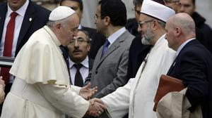 Pope Francis, left, is welcomed by Istanbul Mufti Rahmi Yaran (AP)