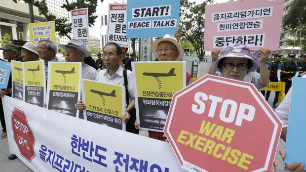 South Korean protesters stage a rally against joint military exercises between the US and South Korea (AP)