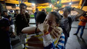 Supporters of opposition leader Leopoldo Lopez were dismayed as they listened to his guilty verdict in Caracas (AP)