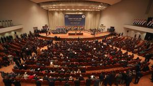 Iraqi politicians attend the session to approve the new government in Baghdad (AP)