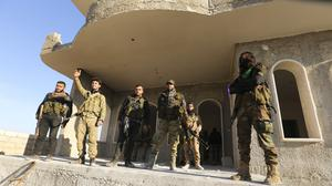 Turkish-backed Syrian rebels enter the town of Saraqeb, in Idlib province (Ghaith Alsayed/AP)