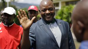 President Pierre Nkurunziza after making a brief statement to the media at the presidential palace in Bujumbura (AP)