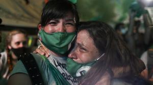 Demonstrators in favour of legalising abortion react after the senate passed an abortion bill in Buenos Aires, Argentina. Photo: Reuters/Agustin Marcarian