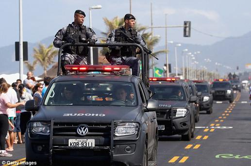Brazilian police guard for the Olympic Torch Relay, Photo: Getty