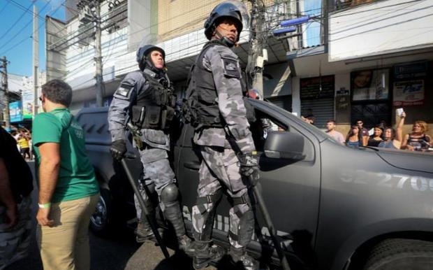 Brazilian military police trail the arrival of the Olympic torch. Photo: Getty Images