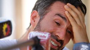 Tears: Neurologist Leopoldo Luque speaks to journalists at his home in Buenos Aires. Photo: Fabian Marelli/ AP