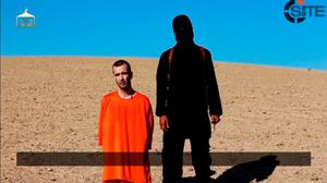 A still image taken from an Islamic State video showing British captive David Haines before he is beheaded.