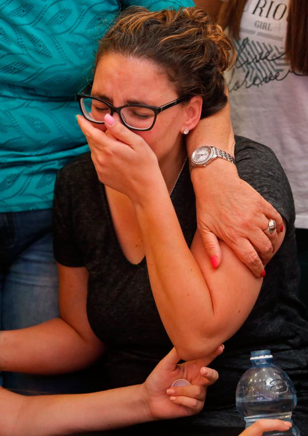 Tal Ovadia, the wife of slain Yotam Ovadia (31), mourns at his funeral in Jerusalem. Photo: Getty Images