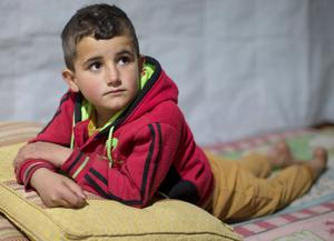 Five-year-old Syrian refugee Abed in the Beqaa Valley, about 30km east of Beirut, Lebanon